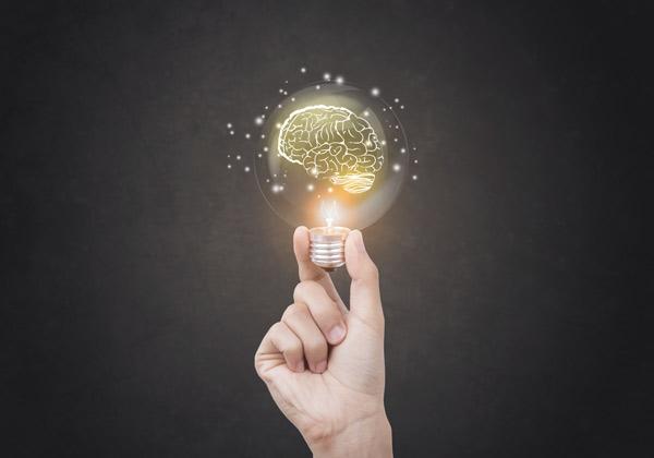 Man holding lightbulb, brainstorming ideas
